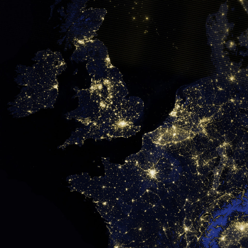Satellite image of southern England at night showing lights and population